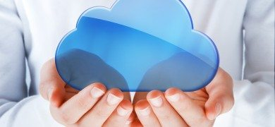 hands exhibiting the blue cloud computing symbol